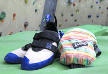Image of climbing Shoes and chalk bag.